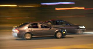 cars racing by Flickr user lindsayshaver